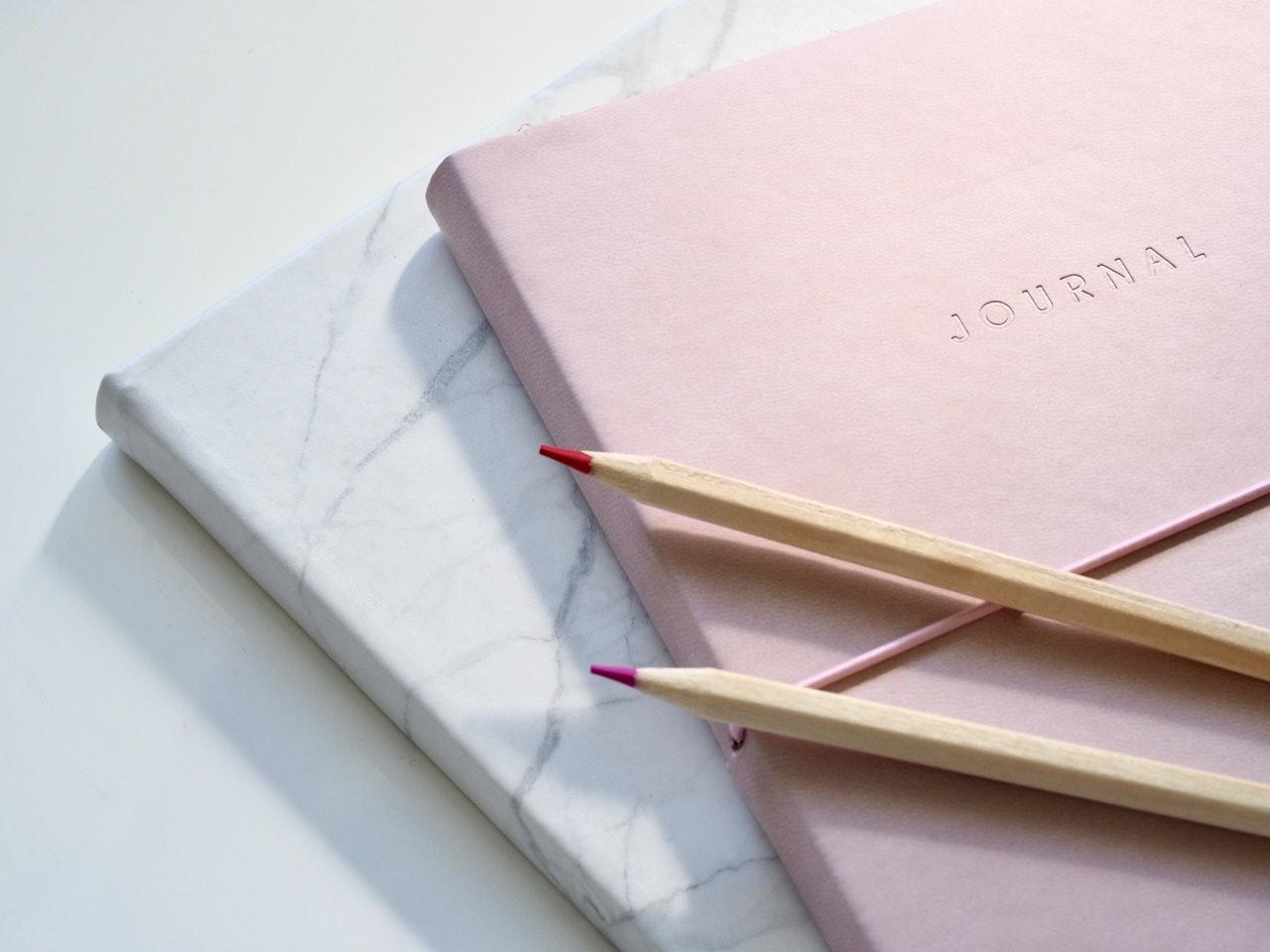 closeup-photo-of-journal-book-and-pencils-1018133.jpg
